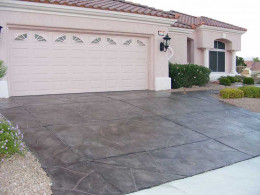 Image of a dark gray flagstone overlay concrete driveway.
