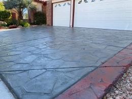 Image of dark gray flagstone overlay concrete driveway.