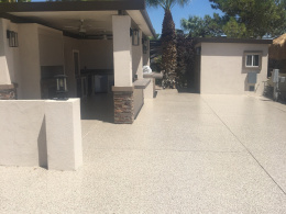 Image of a concrete driveway with an epoxy floor coating chip system.