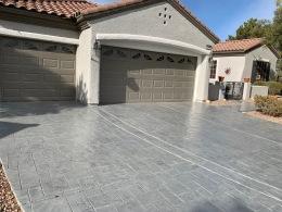 Image of gray textured random stone concrete driveway.