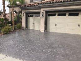 Image of dark gray stamped concrete driveway.