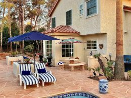 Image of an outdoor entertainment space with wide-cut flagstone overlay on concrete.